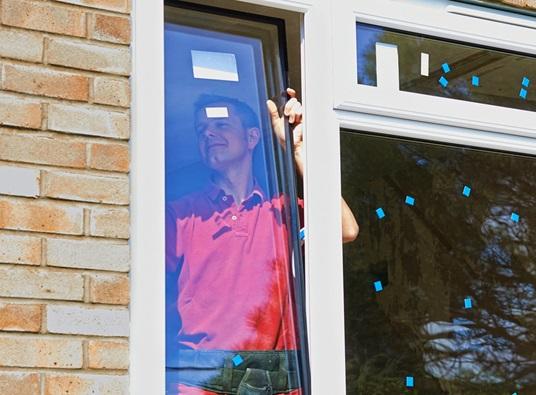 Window Contractor Installing Window